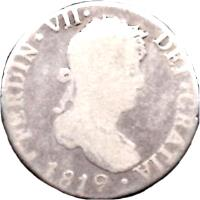 obverse of 2 Reales - Fernando VII - Colonial Milled Coinage (1808 - 1825) coin with KM# 83 from Bolivia. Inscription: FERDIN VII DEI GRATIA 1819