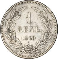 reverse of 1 Real (1869) coin with KM# Pn9 from Honduras.