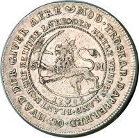 reverse of 1 Riksdaler - Frederik IV (1704) coin with KM# 479 from Denmark. Inscription: MOD.TROSKAB.DAPPERHED.OG HVAD DER GIVER AERE DEN HEELE VERDEN KAND. BLANT NORSKE KLIPPER LARE 6 M. 1704