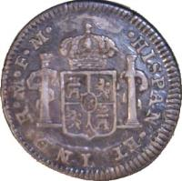 reverse of 1/2 Real - Carlos IV (1790) coin with KM# 71 from Mexico. Inscription: HISPAN *ET* IND * R * M * FM