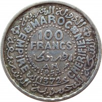 reverse of 100 Francs - Mohammed V (1953) coin with Y# 52 from Morocco. Inscription: MAROC EMPIRE CHERIFIEN 100 FRANCS AN 1953 1372 J.HAINAUT