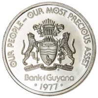 obverse of 25 Cents - 10th Anniversary of Independence: Harpy Self Determination (1976 - 1980) coin with KM# 40 from Guyana. Inscription: OUR PEOPLE - OUR MOST PRECIOUS ASSET ONE PEOPLE ONE NATION ONE DESTINY FM Bank of Guyana · 1977 ·