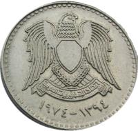 obverse of 50 Piastres - No stars on shield (1974) coin with KM# 108 from Syria. Inscription: اتحاد الجمهوريات العربية ١٣٩٤-١٩٧٤