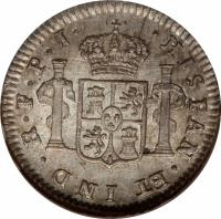 reverse of 1/2 Real - Fernando VII - Colonial Milled Coinage (1814 - 1825) coin with KM# 90 from Bolivia. Inscription: HISPAN.ET IND. R. PTS. P. J.